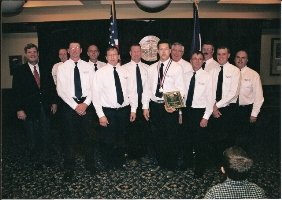 Firefighter John Langstraat receiving an award